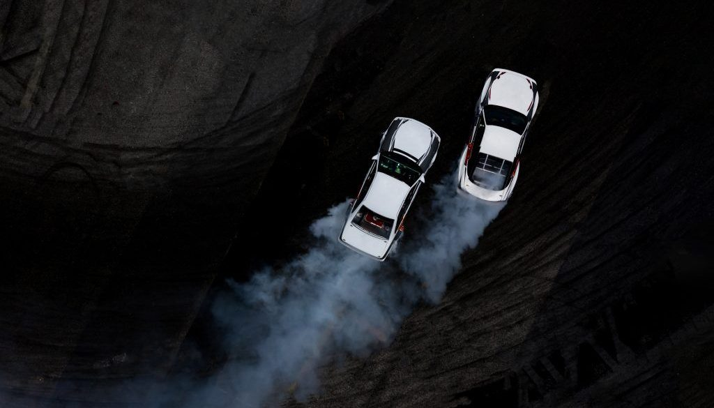 Aerial top view two cars drifting battle on asphalt race track w